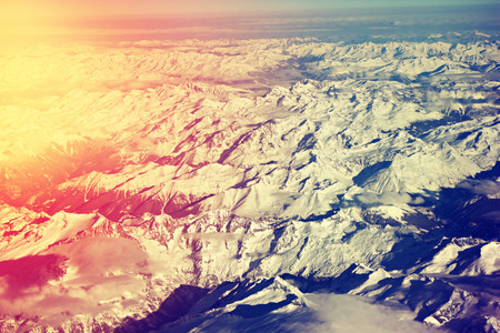filtered: Aerial view of snowy Alps. Filtered image.