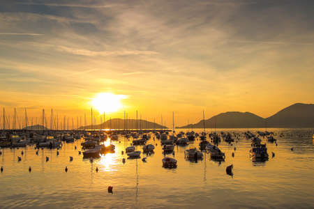 super yacht: Sunset above the sea with many yachts, Lerici, Ligurian province, Italy. Stock Photo