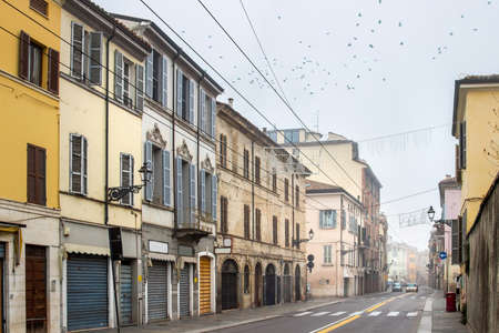 emilia: Historical street with many buildings in cloudy day in Parma, Emilia Romagna, Italy. Stock Photo