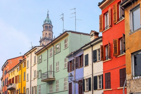 dwelling: Dwelling houses painted in different colors of rainbow in Parma, Italy.