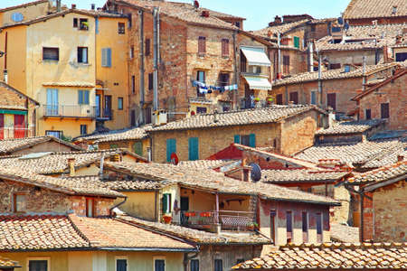 conglomeration: Old medieval city of Siena in summer, Tuscany region, Italy.