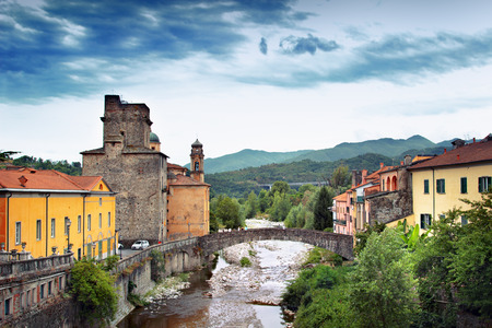 View of historical Pontremoli village with bridge and Magra river, Italy. Stock Photo