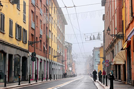 emilia: Empty street with colorful buildings in gray day in Parma, Emilia Romagna province, Italy. Stock Photo