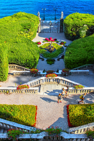VILLA CARLOTTA, ITALY - AUGUST 02, 2015: View of beautiful classic stairs and park with fountain from balcony, villa Carlotta, Como lake, Italy. Editorial