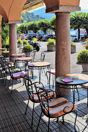 BELLAGIO, ITALY - AUGUST 03, 2015: View from empty street cafe in historic  Bellagio, Como lake, Italy.