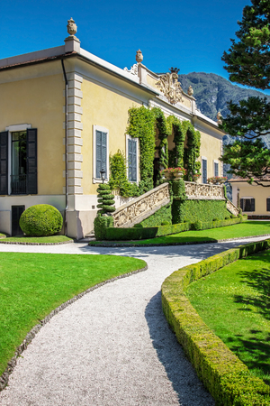 classy house: VILLA BALBIANELLO, ITALY - AUGUST 02, 2015: Pathway leading to classic building in green park at villa Balbianello, Como lake, Italy.