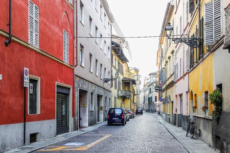 PARMA, ITALY - DECEMBER 22, 2015: Empty street with old style houses in Parma, Italy.