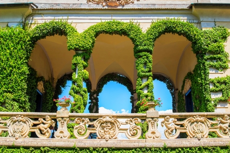 classy house: VILLA BALBIANELLO, ITALY - AUGUST 02, 2015: Beautiful terrace with columns at villa Balbianello, Como lake, Italy. Scene from Star wars movie was filmed here.
