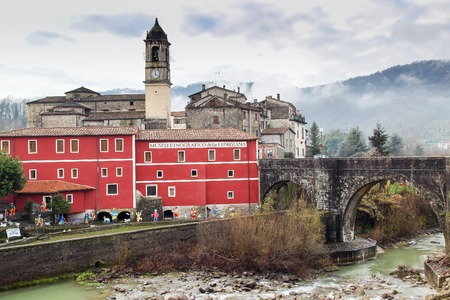 ethnographical: VILLAFRANCA, ITALY - DECEMBER 25, 2015: Ethnographic museum and old stone bridge in medieval town of Villafranca, Lunigiana (Tuscany region) Italy. Editorial