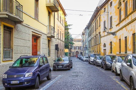PARMA, ITALY - DECEMBER 22, 2015: Old street with parked cars in Parma, Italy.
