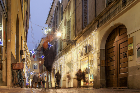 PARMA, ITALY - DECEMBER 27, 2015: Night old illuminated street in the center of Parma, Italy. Editorial