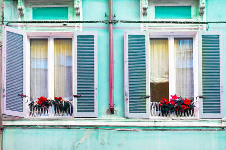 open windows: Two open windows in colorful house, Italy Stock Photo