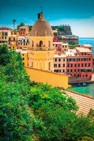 View of the church and many houses of Vernazza, Cinque Terre, Italy.