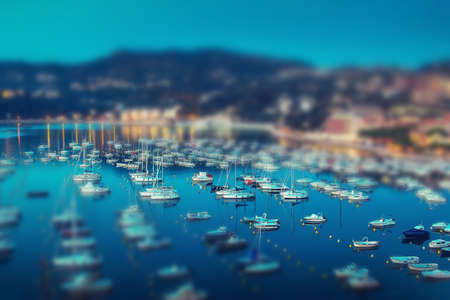 marina life: Yachts in summer evening. Tilt shift effect. Stock Photo