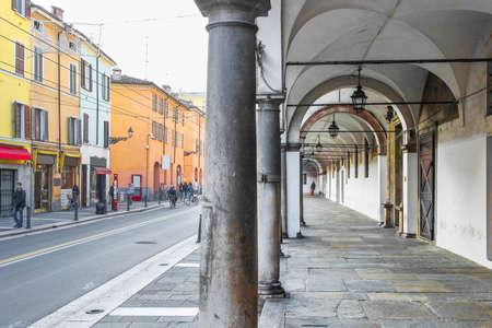 colonnade: Old colonnade and Della Repubblica street in Parma, Emilia Romagna region, Italy.