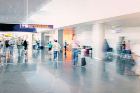 going in: Passengers going in the airport hall. Blurred effect applied on image.