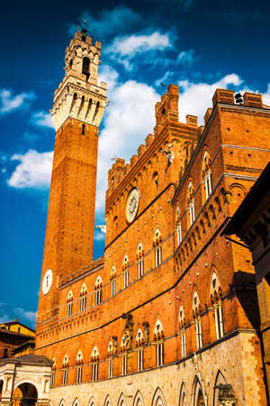 Torre del Mangia tower and town hall in Siena. Tuscany region of Italy. The tower is 88 metres (289 feet) high.