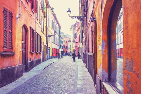 filtered: Orange houses on the street of Parma, Italy. Filtered image. Stock Photo
