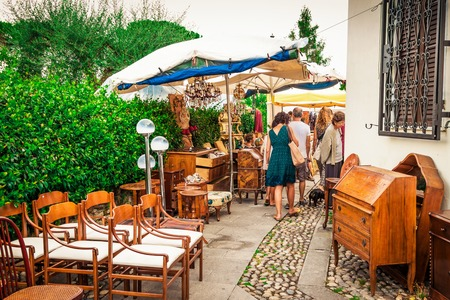 SARZANA, ITALY - AUGUST 10, 2015: People walking at the market of old vintage objects and furniture in small town of Sarzana, Liguria, Italy. Editorial