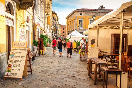 SARZANA, ITALY - AUGUST 10, 2015: Old streets and vintage market in Sarzana, Italy. Editorial