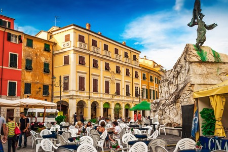 SARZANA, ITALY - AUGUST 10, 2015: People tasting Italian cuisine at the old  square - Piazza Giacomo Matteotti in Sarzana, Liguria, Italy.