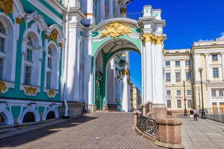 Historic entrance with white columns in Hermitage palace in Saint Petersburg, Russia. Editorial