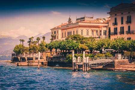 Scenic view of Bellagio on Como lake in summer, Italy. Color filter used.