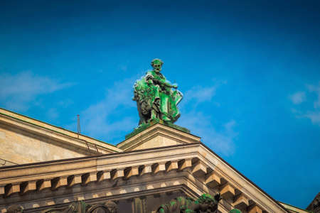 Sculpture of Evangelist Mark with lion on the roof of Isaac cathedral in Saint Petersburg, Russia. Stock Photo