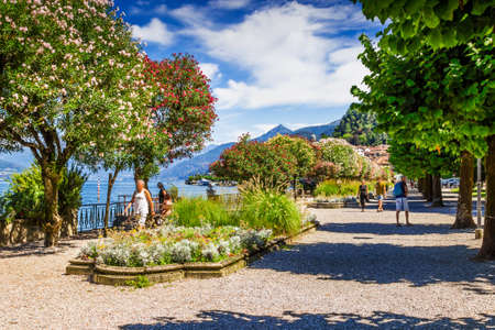 Walking path with trees in Bellagio, Como lake, Italy. Summer. Stock Photo