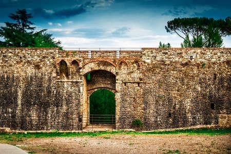 Fortification wall of Fortezza di Sarzanello castle in Sarzana, Liguria region, Italy.