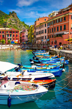 Boats and houses in scenic Vernazza village, Cinque Terre, Italy. Stock Photo