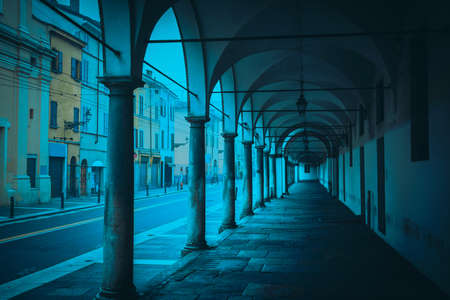 glum: Old colonnade and street in Parma, Emilia-Romagna, Italy.