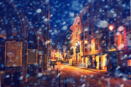 reggio emilia: Scenic snowy old night street in Reggio Emilia, Emilia-Romagna, Italy. Stock Photo