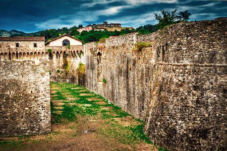 Moat around the fortification of Fortezza di Sarzanello castle in Sarzana, Liguria, Italy.