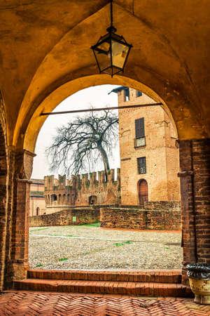 View of medieval Rocca Sanvitale castle through the arch in Fontanellato, Emilia-Romagna, Italy. Editorial