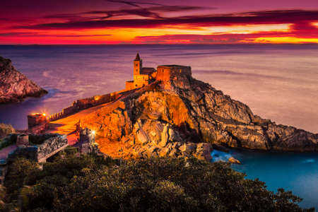 Night view of the gothic church of St. Peter at sunset in Porto Venere, Liguria, Italy.