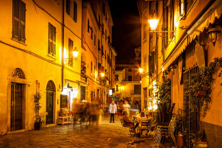 romantic places: Old night street in Sarzana, Liguria, Italy. Stock Photo