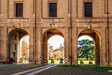 View through the archs of Pilotta palace in Parma, Emilia-Romagna, Italy. Editorial