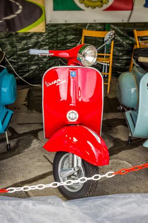 SARZANA, ITALY - AUGUST 10, 2015: Red Vespa bike in Sarzana, Liguria, Italy.