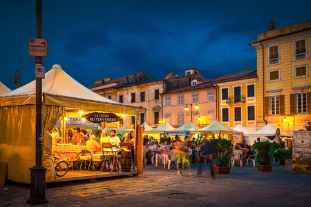 SARZANA, ITALY - AUGUST 10, 2015: People buying traditional Italian dishes on the square - Piazza Giacomo Matteotti in Sarzana, Italy. Summer food festival. Editorial