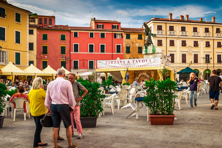 SARZANA, ITALY - AUGUST 10, 2015: People on food festival at the old  square - Piazza Giacomo Matteotti in old Sarzana, Italy. Editorial