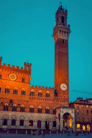 The Torre del Mangia tower in the night in Siena, Tuscany, Italy.