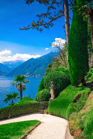 Walkway in the garden with view of Como lake, villa Balbianello, Lombardy, Italy. Stock Photo
