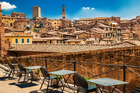 Picturesque view of many medieval houses in historical town of Siena, Tuscany, Italy.