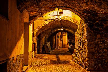 spezia: Ancient street with arch in the night in Santo Stefano di Magra, La Spezia, Italy.