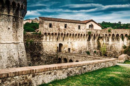 Fortification of Fortezza di Sarzanello castle in Sarzana, Liguria region, Italy.