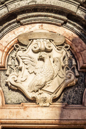 Marble emblem with bird on the church Chiesa di San Giovanni Evangelista in Parma, Emilia-Romagna, Italy.