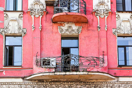 Pink building with beautiful balcony and facade decoration.