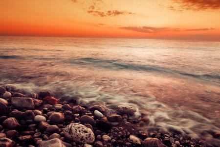 View of sea sunset. Stone coast. Stock Photo