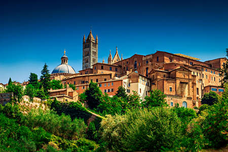 Old architecture of Siena, Tuscany region, Italy. Famous touristic place. Stock Photo
